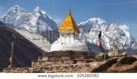 Stupa near Dingboche village with prayer flags and mounts Kangtega and Thamserku - way to mount Everest base camp - Khumbu valley - Nepal