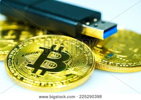 Golden Bitcoin And Usb Flash Drive On White Background
