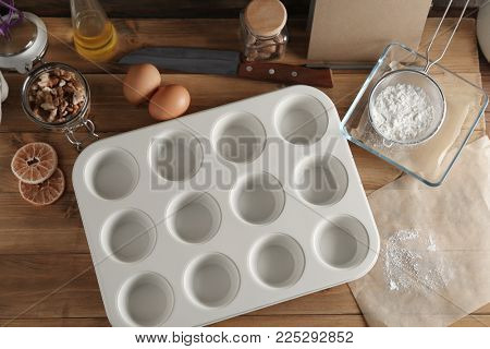 Baking form with ingredients for preparing pastries on table