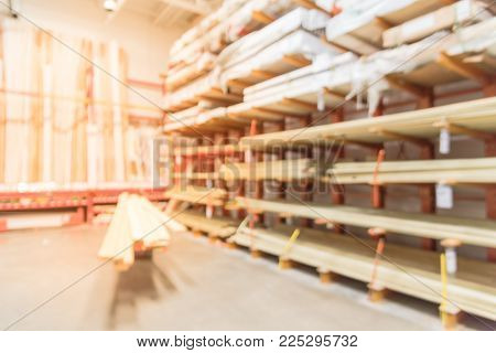 Close-up blurred stack of lumber osb, plywood, mdf, project panel at hardware store in America. Wooden bars, flake board, sterling board on shelves inside lumber yard of home improvement retailer poster