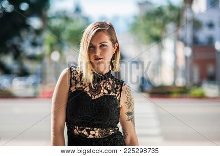 Pretty Young Woman In Black Lace Formal Gown Backlit By Downtown City Of Ventura On Sunny Winter Day