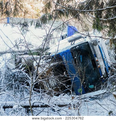 Moscow region, Russia - February, 2, 2018: the truck turned over in a ditch on a snow-covered road in Moscow region, Russia