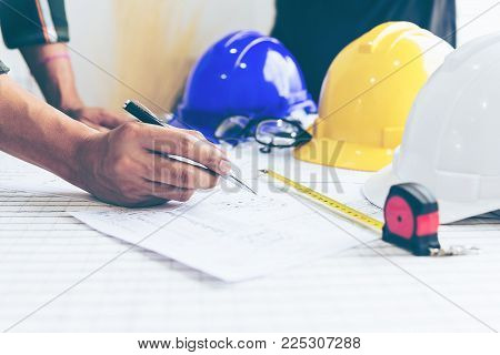 Engineer Architect working table with safety helmet,Design concept . construction safety concept .