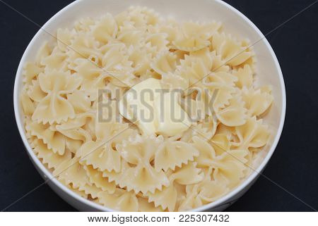Farfalle Pasta in Bowl with Butter Close Up