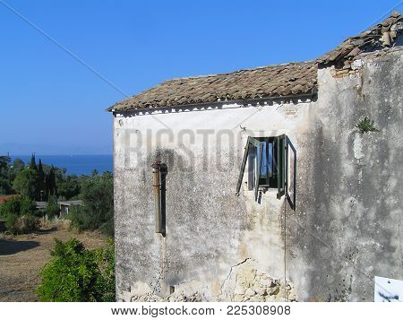 An old empty stone house on the island of Corfu, in Moraitika