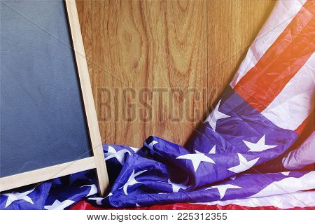 Chalkboard And Usa Flag On Brown Wooden Wall Scene
