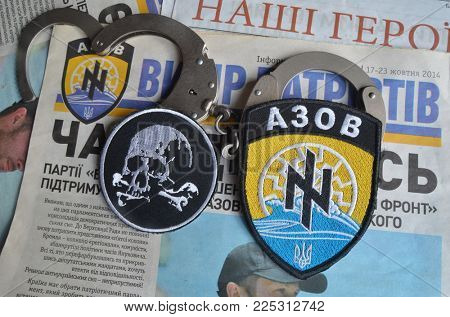 Illustrative Editorial.  Azow nazionalist formation chevron and   newspaper - Selection of patriots. Circa 2014. February 3, Kiev,Ukraine