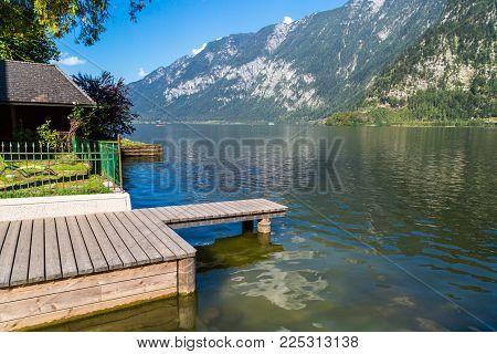 Hallstatt Lake With Pier In Clear Water