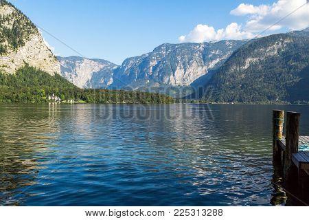 Lake Hallstatt With High Alp Mountains