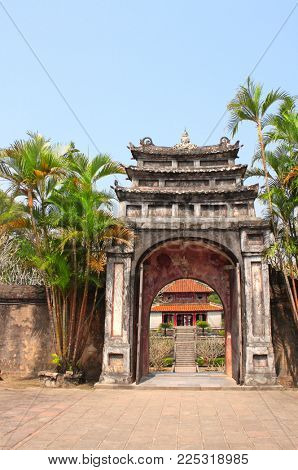 Ancient stone gate in Imperial Minh Mang Tomb of the Nguygen dynasty in Hue, Vietnam. UNESCO world heritage site