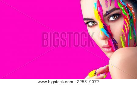 Fashion Model Girl colorful face paint. Beauty fashion art portrait of beautiful woman with flowing liquid paint, abstract makeup. Vivid paint make-up, bright colors. Multicolor creative make-up