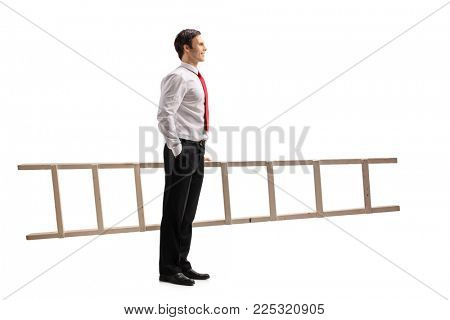 Full length profile shot of a formally dressed guy with a ladder waiting in line isolated on white background