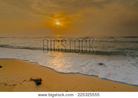Sunrise at Koh Samui along coral coastline.
