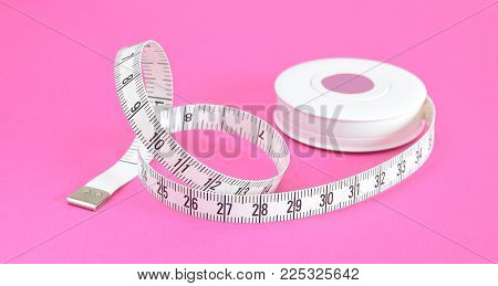 White Measuring Tape Box Isolated On Pink