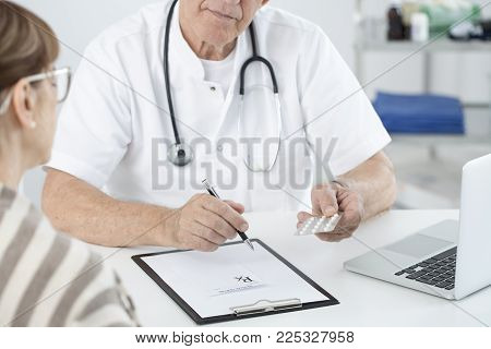 Doctor Holding Painkillers