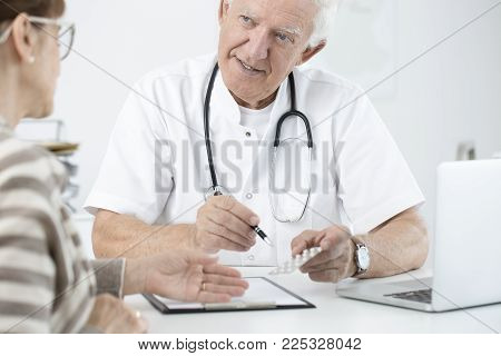 Doctor Showing Medicine