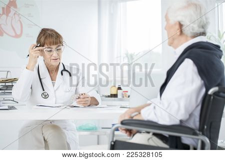 Doctor Explaining Medicine Taking