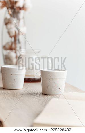 Cup of coffee, branch of tree, wooden windowsill. In the background white window. poster