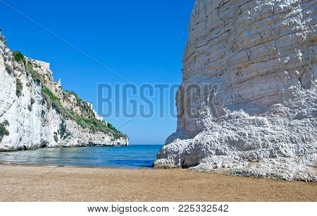 Vieste, Italy, view of the Pizzomunno monolith on the beach of the village