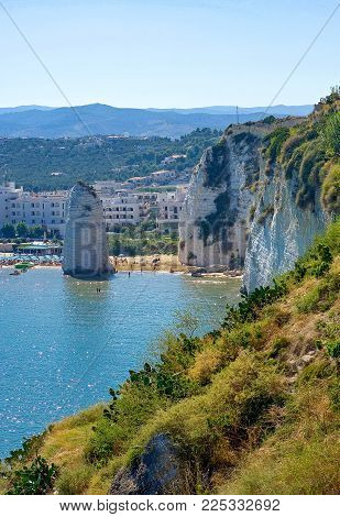 Vieste, Italy - Septembe 5, 2006: View of the Pizzomunno monolith on the beach of the village