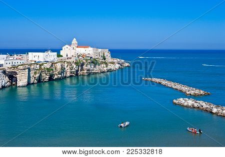 Vieste, Italy - Septembe 5, 2006: View of the St.Francis promontory on the sea