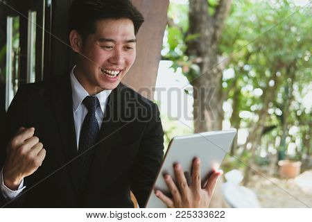 Successful Business Man Checking Tablet Message & Raise Fist With Happiness And Gladness Outside Off