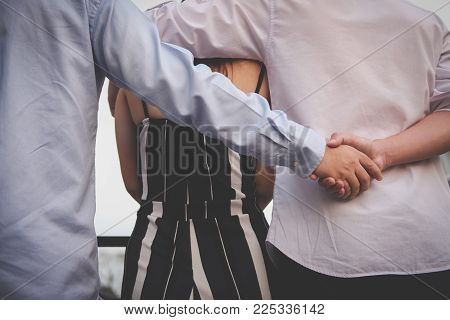 Homosexual Man Hug Woman While Holding Hands With Secret Lover. Gay Couple In Love Triangle. Boyfrie
