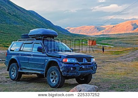 ALTAI, RUSSIA - 12 AUGUST 2015: Off-road vehicle at the mountain pass