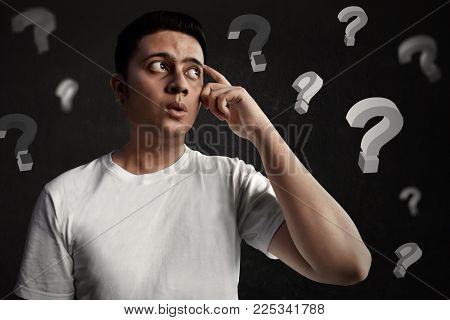 Young asian man thinking and confused expression