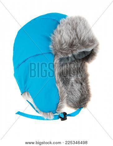 Warm fur cap on a white background