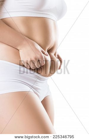 Side view of woman with fat belly. Obesity concept. Isolated on white background.