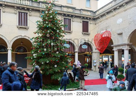 Bergamo, Italy - December 2017: People Are Having Fun Near Christmas Tree  At Old Square Of Town.