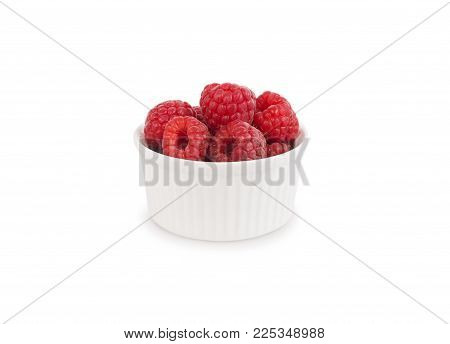 Raspberries in a bowl isolated on white background. Vegetarian or healthy eating. Juicy and delicious raspberry with copy space for text.