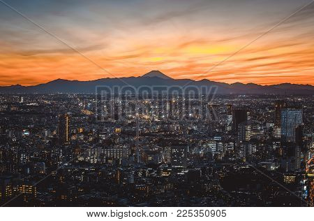 Tokyo Skyline And Buildings From Above, View Of The Tokyo Prefecture With Fuji Mount In The Backgrou
