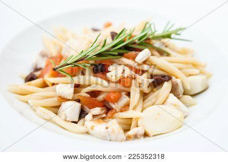 Pasta with sea bream and a juniper branch