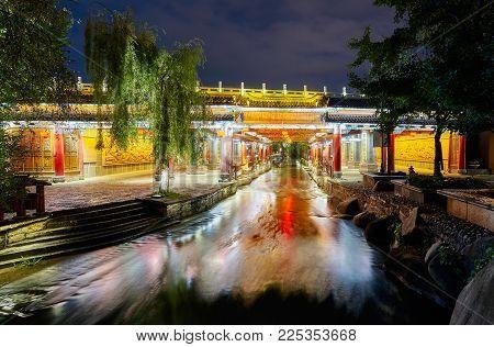 Bridge In Old Town Of Lijiang At Night, China.