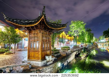 Old town of Lijiang at night. This historical center, also known as Dayan, was registered on the UNESCO World Heritage List in 1997, China.