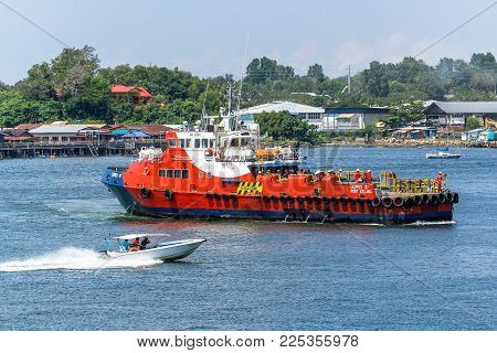 Labuan,Malaysia-Feb 2,2018:Offshore oil & gas sea support vessel with workers at port of Labuan,Malaysia.The vessels were designed & built to comfortably & efficiently transport workers between the mainland and offshore work sites in Labuan,Malaysia.