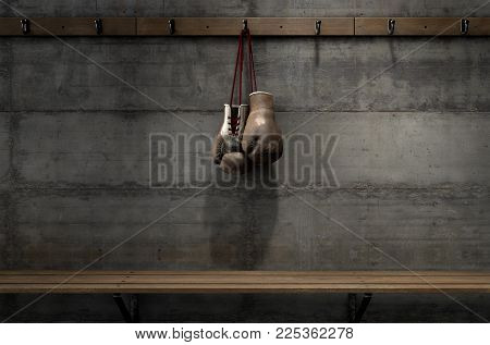 Worn Vintage Boxing Gloves Hanging In Change Room