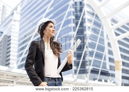 Portrait Of Attractive Architect Woman Standing At Outdoor Place. People Working Concept.