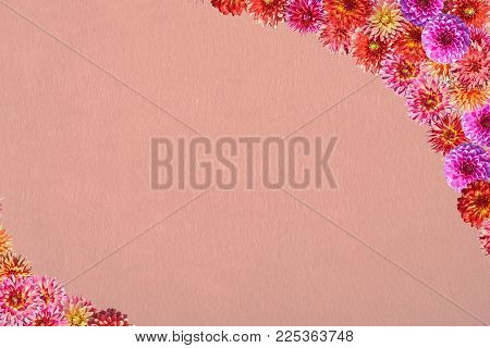 Postcard with a frame of flowers on a background of synthetic fibrous nonwoven material. Collage of photos of dahlias of eight varieties