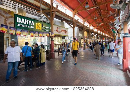 DUBAI, UNITED ARAB EMIRATES - JAN 02, 2018: City of gold is a bazaar in Dubai with a lot of shops who sell golden jewelry. It's a famous place visited by tourists.