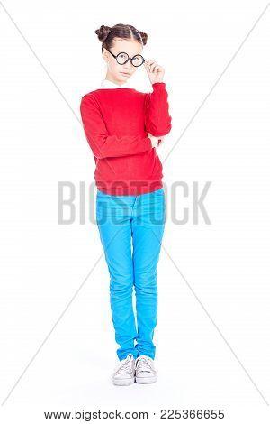 Isolated portrait of Asian schoolgirl wearing nerd eyeglasses