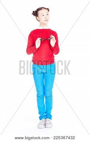 Isolated portrait of Asian schoolgirl holding nerd eyeglasses
