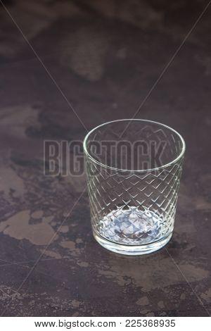Empty Glass Beaker On A Dark Background
