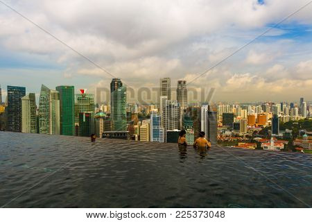 SINGAPORE - APRIL 15: Pool on roof and Singapore city skyline on April 15, 2016 in Singapore.