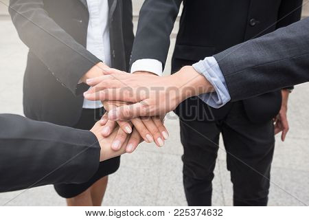 Business Team Gather Hands On Top Of Each Other