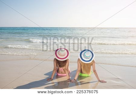 Young Fashion Woman Relax On The Beach.summer Vacation Holiday.hot Beautiful Woman In Bikini On The