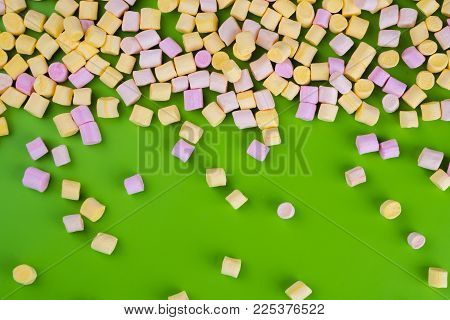 Marshmallows On Green Background With Copyspace. Flat Lay Or Top View. Background Or Texture Of Colo