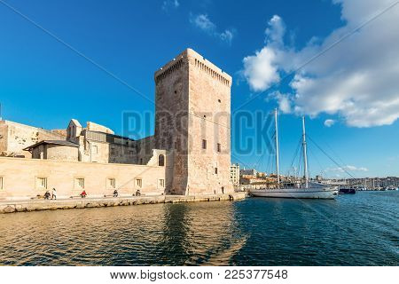 Marseille, France - December 4, 2016: View From The Sea To The Fort Saint-jean And Traditional Rig S